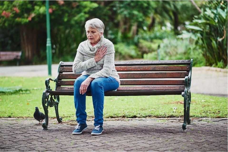 Woman Sitting on Bench Heart Attack